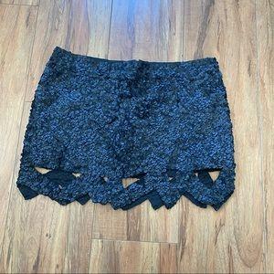 Aje. Black sequin catara mini skirt